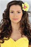 beautiful woman in a yellow dress with flower in her hair.