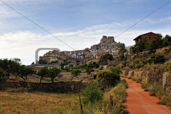 Morella in Spain. Landscape with rural road with castle and town