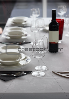 Table setting with plates and wine glasses
