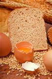 Wheat bread, grain and ears with eggs