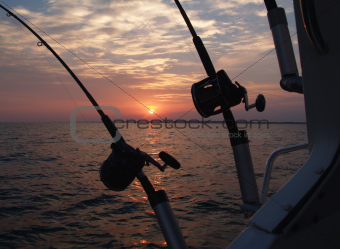 Trolling Fishing Poles Silhouetted in Front of a Sunrise