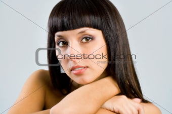 pretty woman with long straight black hair looking at camera, is