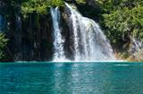 Waterfall and sea-green lake in Plitvice Lakes National Park (Cr