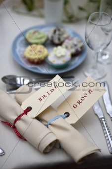 bride and groom table setting