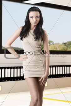 pretty brunette with short dress in front of the camera