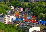 Multicolored houses among the green trees Kiev, Ukraine