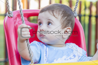 baby boy in swing
