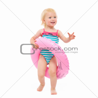Happy baby in swimsuit with inflatable ring