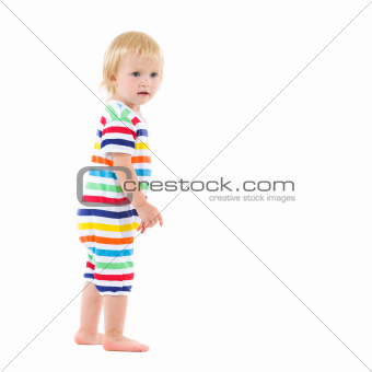Full length portrait of thoughtful baby in swimsuit