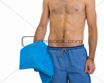 Closeup on man holding blue beach towel