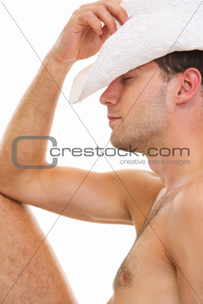 Young man in hat sitting relaxing