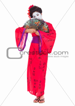 Full length portrait of geisha hiding behind fans isolated on white