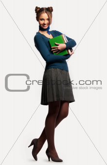 girl with a bunch of books