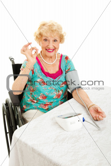 Disabled Senior Monitors Her Blood Pressure