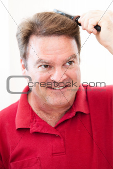 Man Brushing His Hair