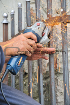 Worker hands with grinder