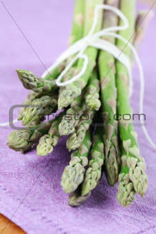 Green asparagus on purple napkin