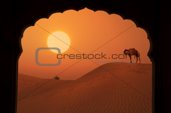 silhouette of arabic architecture on desert