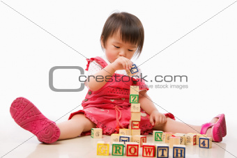 Asian female toddler playing