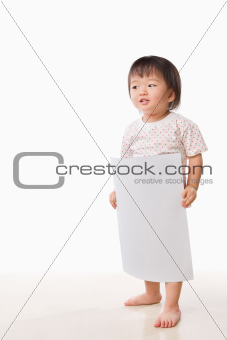 Asian female toddler holding white paper