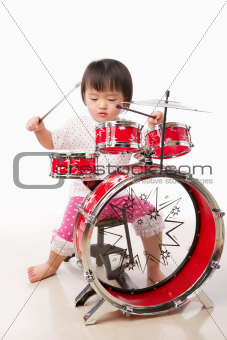 Little girl playing drum