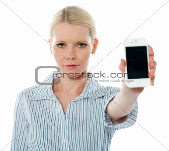 Corporate female communicating on phone against white background
