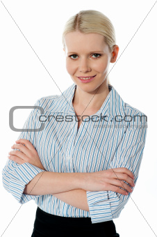 Glamourous female executive posing with folded arms