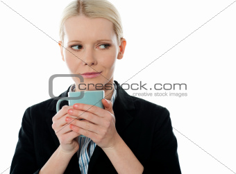 Coporate woman holding coffee mug