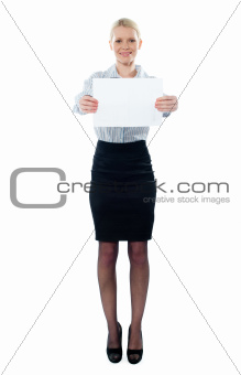 Caucasian female executive holding a blank billboard