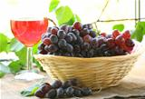 black organic grapes in a wicker basket