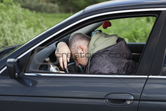 Drunk man asleep at the wheel