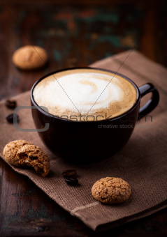 Cup of cafe au lait and biscotti