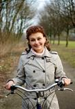 Happy woman riding a bicycle