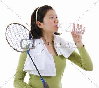 Drinking water after playing badminton