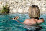chihuahua and girl in the water