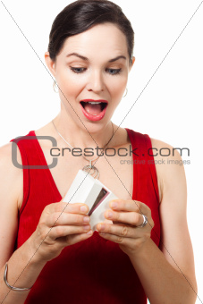 Surprised woman opening a jewelery box