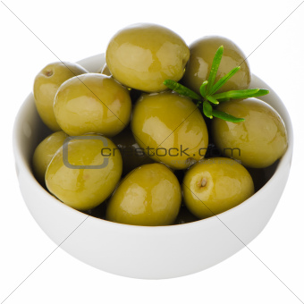 Green olives in a white ceramic bowl