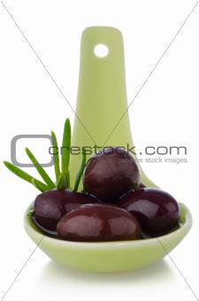 Olives on ceramic spoon