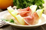 Traditional Italian appetizer, ham  Prosciutto with melon