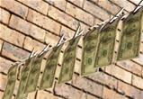 One hundred dollar bills is hanging on rope