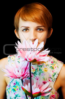 Lovely woman in floral dress holding flowers