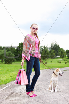 Girl with shopping bags standing on the track