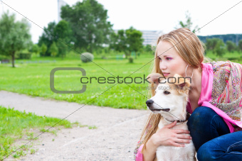 beautiful girl hugging his dog
