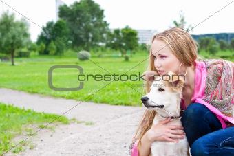 beautiful girl hugging his dog