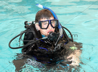 Young man in scuba diving equipment.