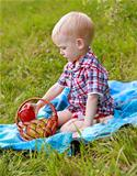 Child having picnic on the green meadow