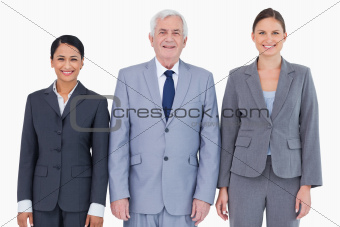 Three smiling businesspeople