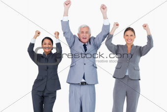 Three cheering businesspeople