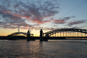 Neva river and Bridge Peter the Great at sunset