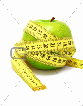 Apple and measuring tape (isolated)